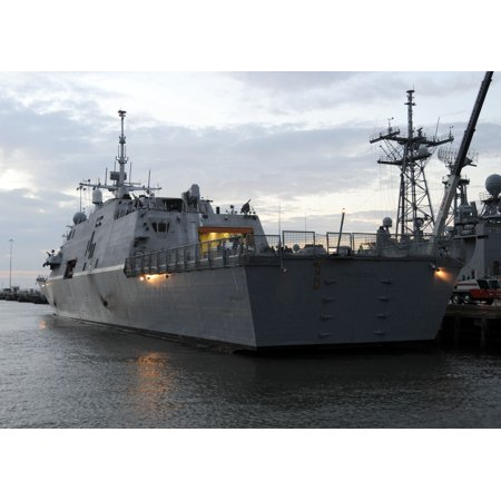 LAMINATED POSTER The littoral combat ship USS Freedom (LCS 1) is moored to the pier for her first night at Naval Stat Poster Print 24 x - Halloween Night Uss Dates