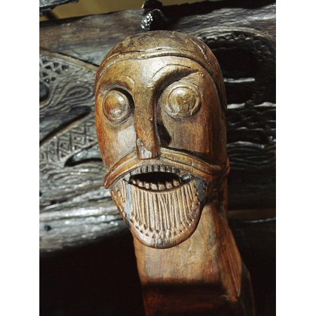 Fierce human mask carved on the side of the Oseberg cart, Viking, Norway, c850 Print Wall Art By Werner Forman ()