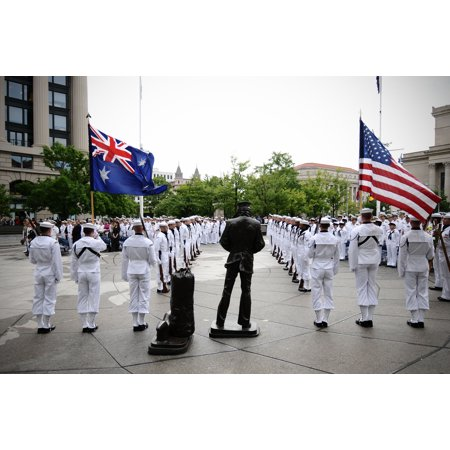 Ceremonial Statue - LAMINATED POSTER Members of the U.S. Navy Ceremonial Guard post the colors near the Lone Sailor statue at the U.S. Na Poster Print 24 x 36