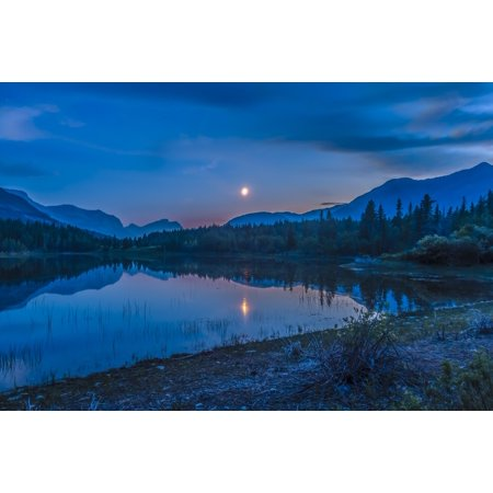 Waxing Crescent Moon (July 2 2014 - The waxing crescent moon over Middle Lake in Bow Valley Provincial Park Alberta Canada east of Banff and Canmore Poster)