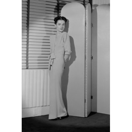 Portrait of young woman standing behind screen partition Stretched Canvas -  (24 x 36) ()