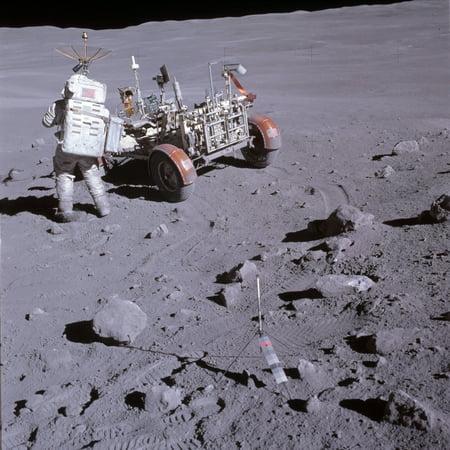An astronaut and a lunar roving vehicle during an Apollo moonwalk Canvas Art - Stocktrek Images (28 x 28)