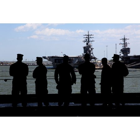 Uss Wasp Aircraft Carrier (LAMINATED POSTER Marines watch the moored aircraft carriers pass by as the USS Wasp departs out to sea from Naval Sta Poster Print 24 x 36 )