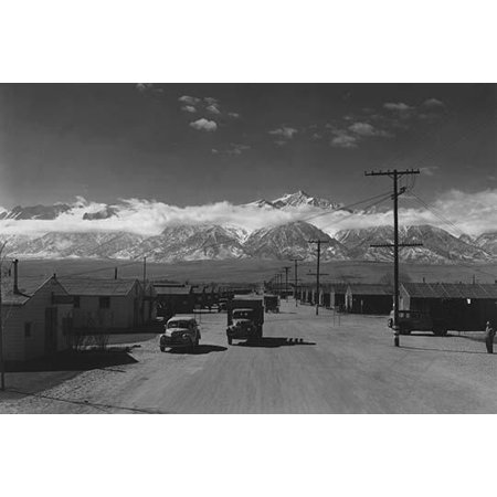 Two way traffic in the camp and camp buildings  Ansel Easton Adams was an American photographer best known for his black-and-white photographs of the American West  During part of his career he was