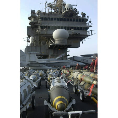 Uss Constellation Cv 64 (LAMINATED POSTER Assorted bombs are raised to the flight deck on elevators aboard USS Constellation (CV 64) for loadi Poster Print 24 x 36 )