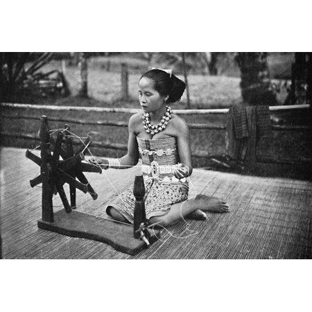 A Dayak girl at her spinning wheel, 1902 Print Wall Art ()