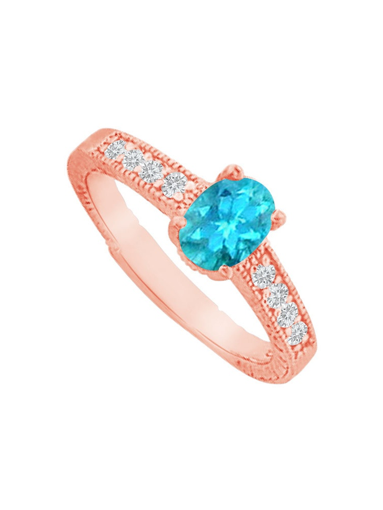Blue Topaz and Cubic Zirconia Prong Set Ring in Rose Gold Vermeil by Love Bright