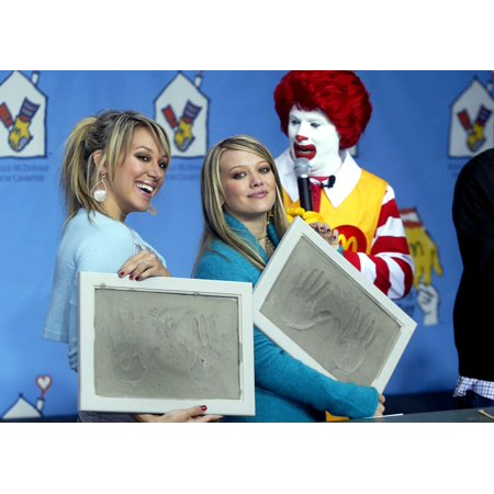 Haylie And Hiilary Duff Hold Handprints Off Themselves At The McdonaldS World ChildrenS Day Kick Off In Los Angeles California November 9 2004  (Poem On Childrens Day November 14 In English)