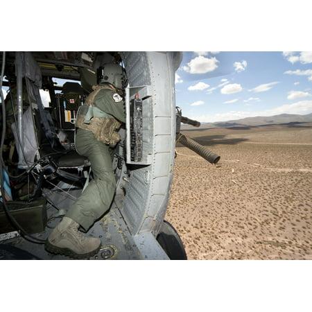 A HH-60G Pave Hawk gunner fires his GAU-17 machine gun Canvas Art - Erik RoelofsStocktrek Images (35 x 23)
