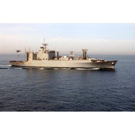 Military Sealift Command Ships - LAMINATED POSTER An SH-60 Seahawk helicopter picks up ordnance from the Military Sealift Command ammunition ship USNS Poster Print 24 x 36