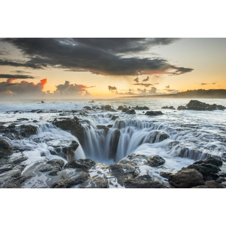 Surf spills into a hole in a rock outcrop on the east side of Kauai Kauai Hawaii United States of America
