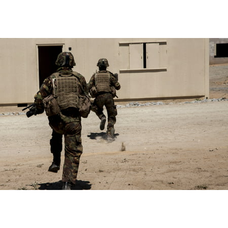 LAMINATED POSTER New Zealand soldiers run to a building during a training exercise during exercise Dawn Blitz aboard Poster Print 24 x 36