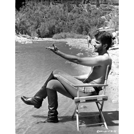 George Hamilton shirtless beside a lake Photo Print