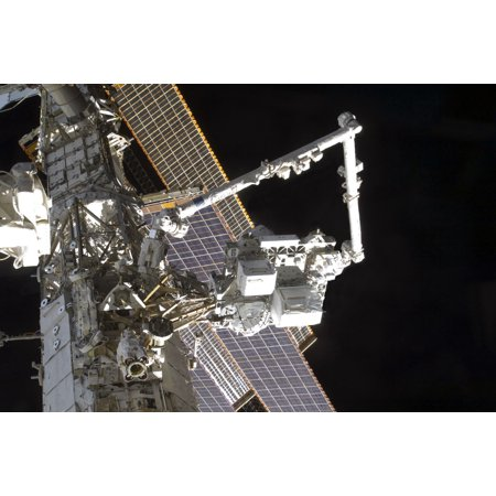 The Canadarm2 Mates The Express Logistics Carrier To The Outboard Payload Attachment System Poster Print