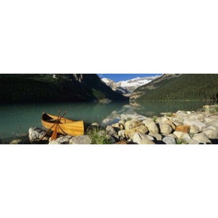 Canoe at the lakeside Lake Louise Banff National Park Alberta Canada Poster Print