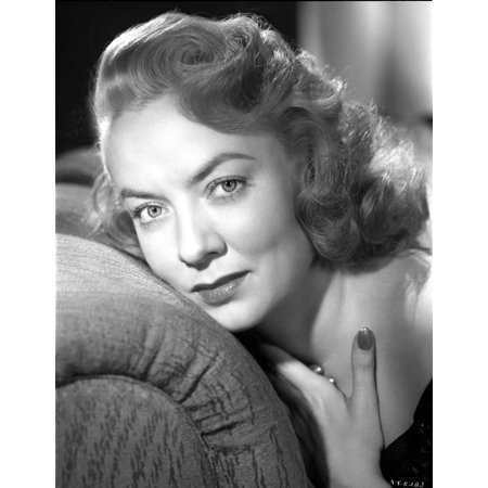 Audrey Totter Lying on Couch Portrait Photo - Trotter Photos