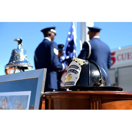 LAMINATED POSTER A Buckley Air Force Base firefighter helmet is displayed during a Patriot Day ceremony Sept. 9, 2016 Poster Print 24 x