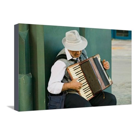 Male accordion player in town center of Sevilla, Andalucia, Southern Spain Stretched Canvas Print Wall Art - Compton Town Center