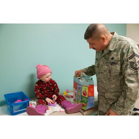 LAMINATED POSTER Members of the 163d Reconnaissance Wing, 163d Maintenance Group, deliver toys to children who are pa Poster Print 24 x 36