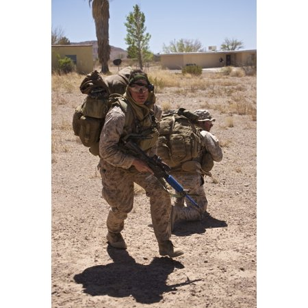 US Marine runs to the UH-60 Black Hawk helicopter at Playas Training Area New Mexico during exercise Angel Thunder 2013 Poster Print