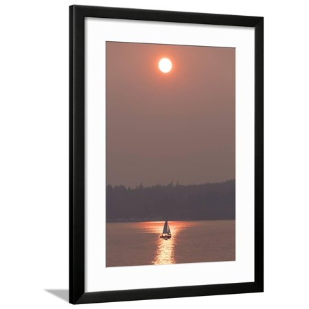 USA, Washington State. Two people in sailboat. Smoky skies from wildfires create eerie sunset Framed Print Wall Art By Trish