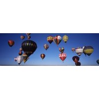 Hot air balloons floating in sky Albuquerque International Balloon Fiesta Albuquerque Bernalillo County New Mexico USA Stretched Canvas - Panoramic Images (27 x 9)