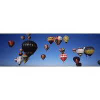Hot air balloons floating in sky Albuquerque International Balloon Fiesta Albuquerque Bernalillo County New Mexico USA Canvas Art - Panoramic Images (27 x 9)