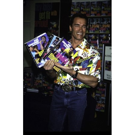 Arnold Schwarzenegger with his books Arnolds Fitness for Kids Photo