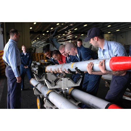Laminated Poster Sailors Manually Lift Ordnance Aboard The Aircraft Carrier Uss Nimitz  Cvn 68  During A Missile Swa Poster Print 24 X 36