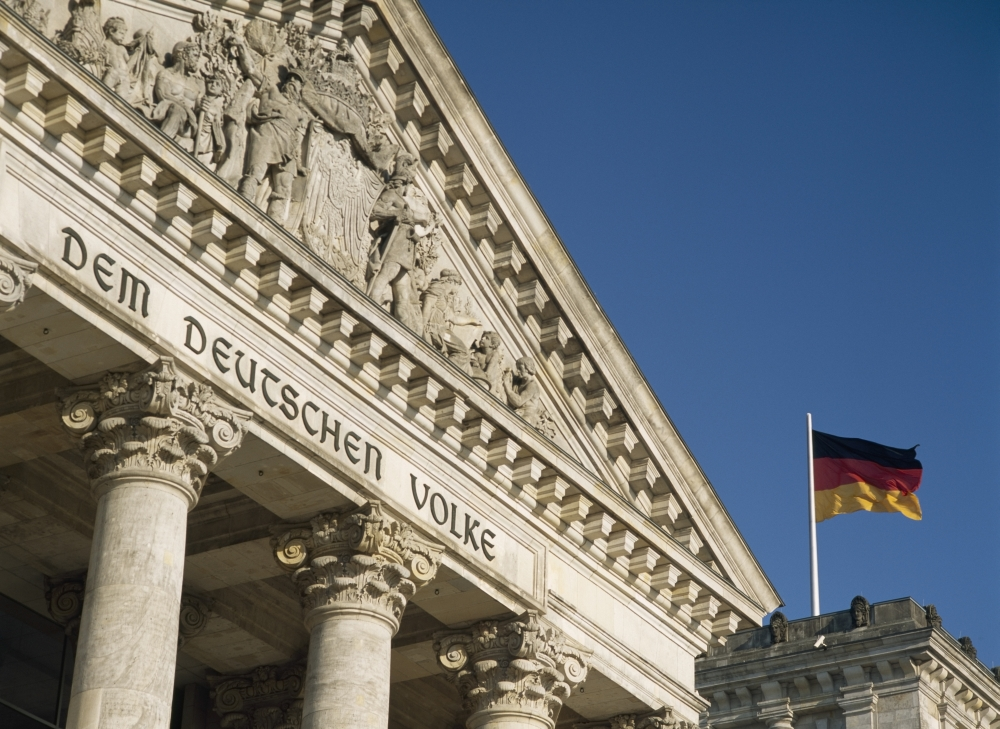Detail Of Bundestag (Reichstag) With German Flag In Front PosterPrint by Design Pics