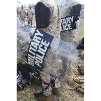 US Marines and Sailors don riot gear for drills during Exercise Lethal Breeze Poster Print