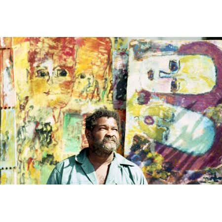 Artist Purvis Young Stands in Front of One of His Paintings, Outside His House in Overtown, 1993 Print Wall