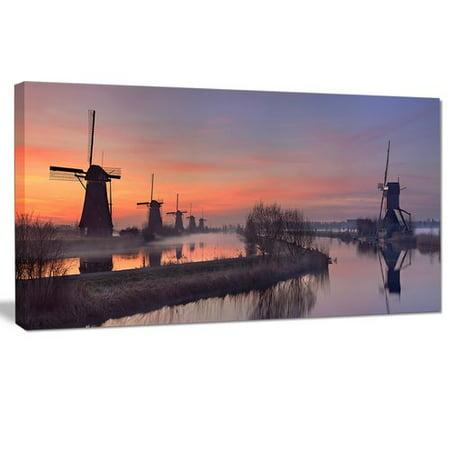 Orange Windmill - Design Art 'Windmills at Sunrise Panorama' Photographic Print on Wrapped Canvas
