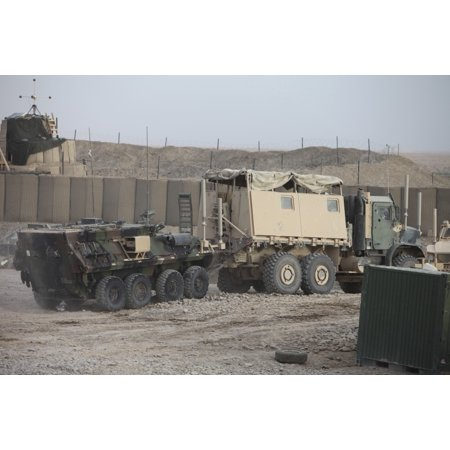 Marines with Combat Logistics Battalion 5 tow a light armored vehicle at Forward Operating Base Payne Afghanistan Poster (Marine Light Armored Vehicle)