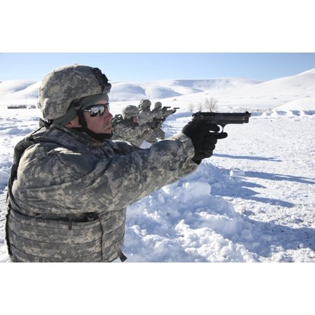 February 26 2014 - US Army Soldier fires a 9mm Berretta pistol while competing in the Army Reserve Medical Commands 2014 Best Warrior Competition on Fort Harrison Montana Poster (Best Mid Size 9mm Handgun)