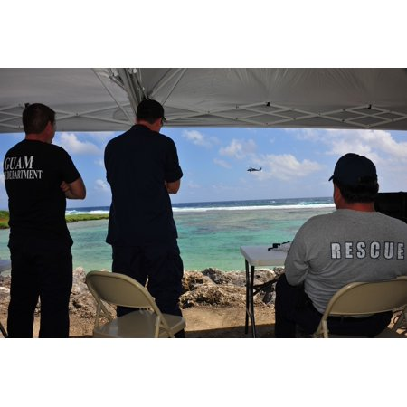Navy Helicopter Sea Combat Squadron 25 crew radios to Guam Fire Rescue Department their search patte Poster Print 24 x 36