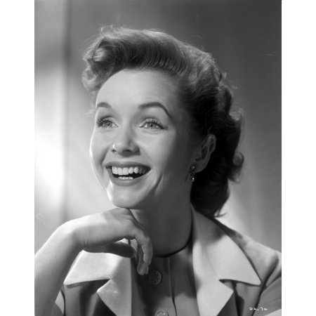 Debbie Reynolds smiling in Trench Coat with Hand on Her Chin Photo - Reynolds Photo