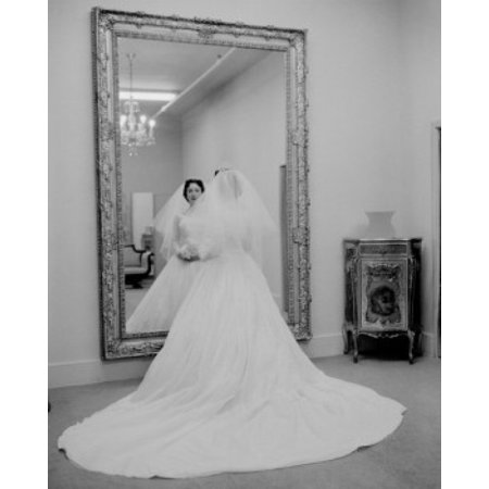 Bride wearing wedding dress looking in mirror canvas art for Mirror 18 x 24