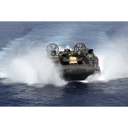 Red Sea May 25 2013 - A landing craft air cushion from Assault Craft Unit 4 approaches the amphibious assault ship USS Kearsarge Poster Print