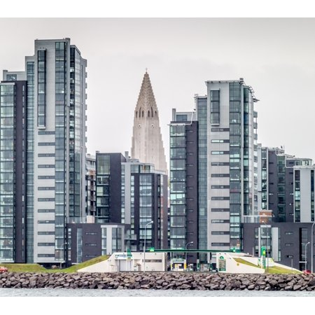 Modern apartment buildings surrounding Hallgrimskirkja Church Reykjavik  Iceland Poster Print