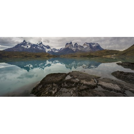 Reflection of mountain peaks in a lake Torres Del Paine Cordillera Paine Lake Pehoe Torres Del Paine National Park Chile Stretched Canvas - Panoramic Images (36 x - Cordillera One Light