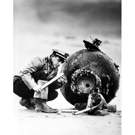 Mine Disposal 1947 Nlieutenant Df Winslow Of The Us Navy Examines The Detonator On A Japanese Sea Mine That Had Floated Ashore Near Newport Oregon 12 December 1947 More Than Two Years After The End Of