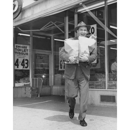 Mid adult man carrying shopping bags in front of a store Canvas Art -  (18 x 24)](Adults Shopping)
