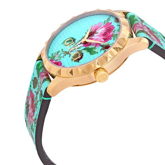 2805961b5e2 Dress watch style. Watch label  Swiss Made. Gucci G-Timeless Aqua Floral  Print Dial Ladies Leather Watch YA1264085. Hour