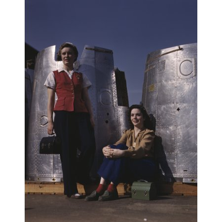 1942 Aircraft - Two female assembly line workers enjoy a lunch break at Douglas Aircraft Company 1942 Poster Print by Stocktrek Images