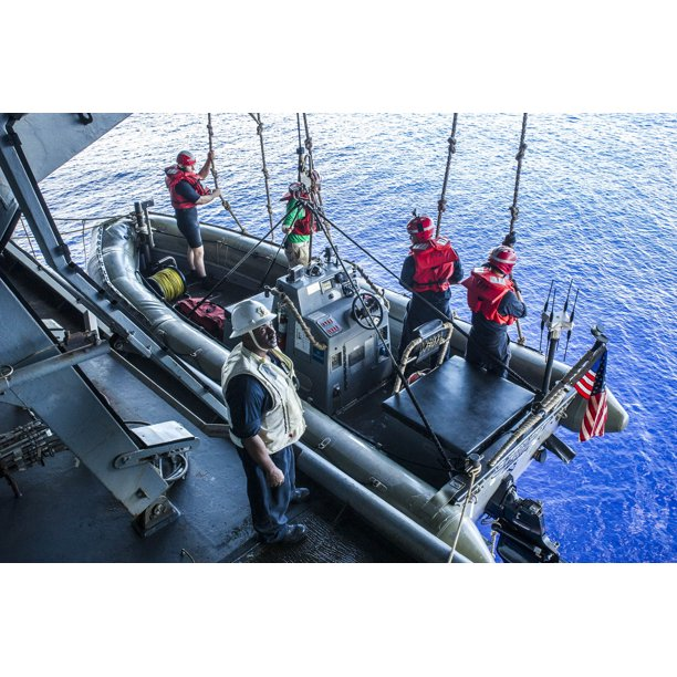 LAMINATED POSTER U.S. Sailors launch a rigid-hull inflatable boat aboard the aircraft carrier USS George Washington i Poster Print 20 x 30