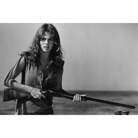 Jacqueline Bisset in The Deep holding rifle in skimpy shirt on boat 24x36 Poster