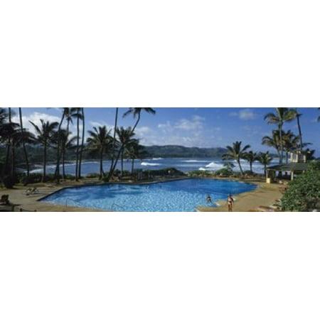 Tourists at an infinity pool Hawaii USA Poster Print