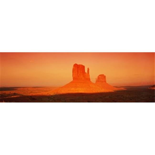 Buttes at sunrise  The Mittens  Monument Valley Tribal Park  Monument Valley  Utah  USA Poster Print by  - 36 x 12 - image 1 de 1