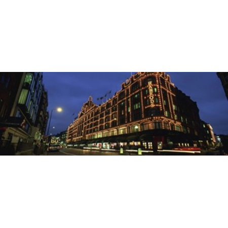 Low angle view of buildings lit up at night Harrods London England Canvas Art - Panoramic Images (36 x 13)